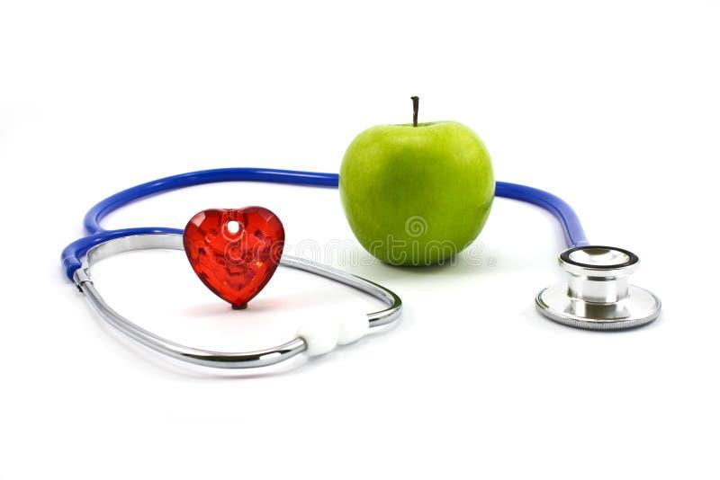 Apple e stetoscopio fotografia stock
