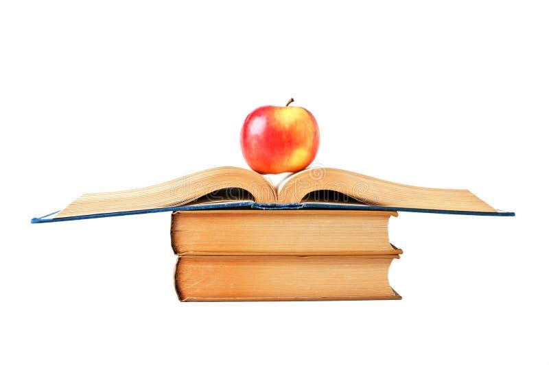 Apple e um livro aberto imagens de stock