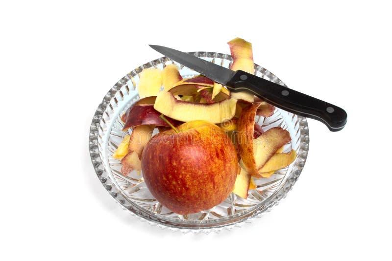 Apple e un coltello fotografia stock libera da diritti