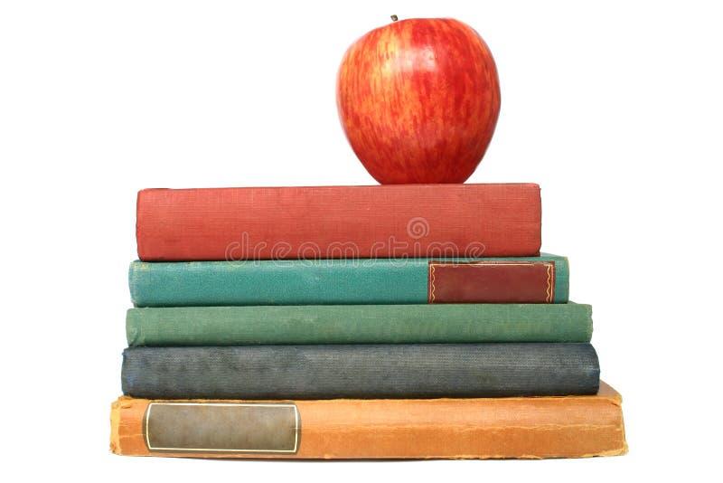 Apple e vecchi libri fotografie stock