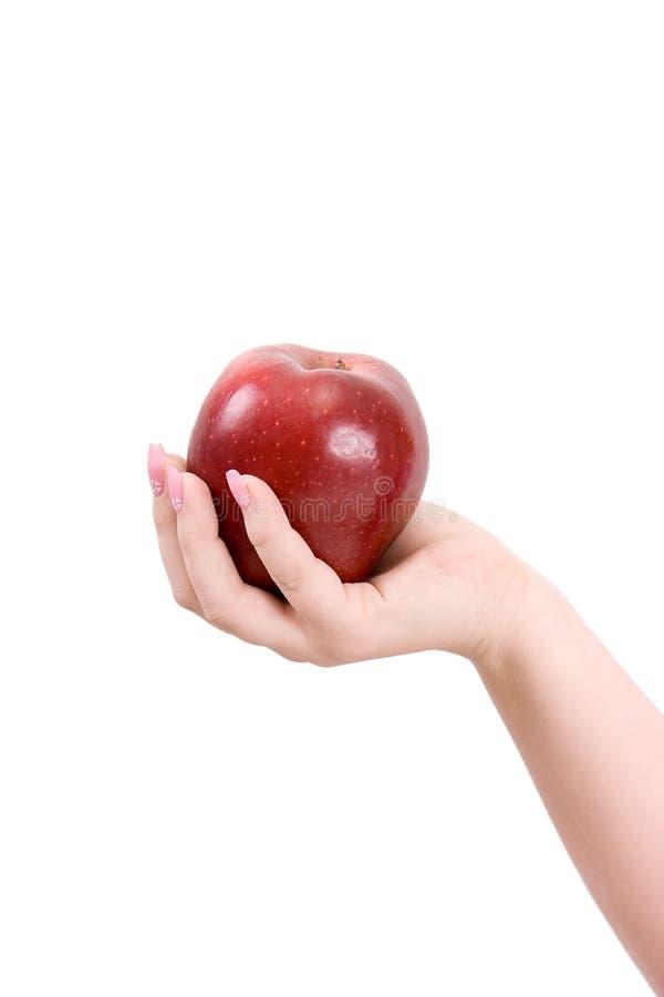 Apple em uma palma fotografia de stock