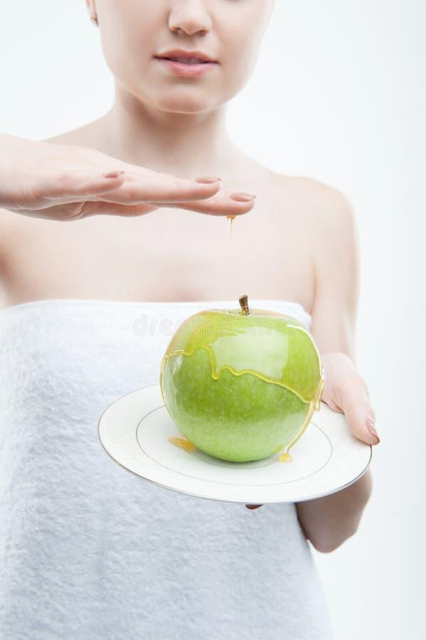 Apple en het portret van de honingsclose-up stock afbeelding