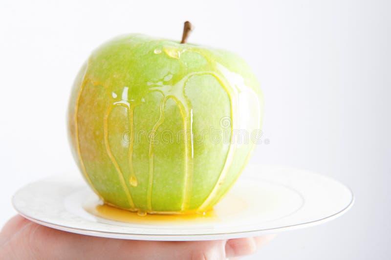 Apple en het portret van de honingsclose-up stock afbeeldingen