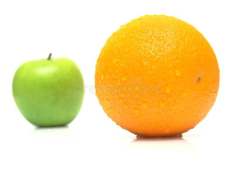 Apple en sinaasappel royalty-vrije stock foto's