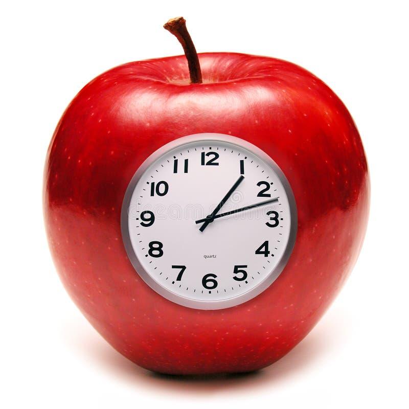 Apple et horloge photos libres de droits