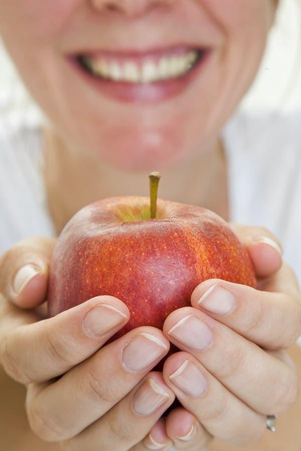 Apple et sourire photographie stock libre de droits