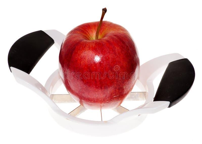 Apple et trancheuse image libre de droits