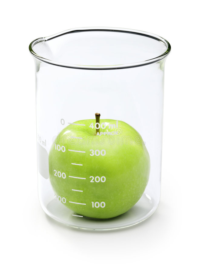 Apple Food Testing Science. An apple in a beaker about to be tested stock image