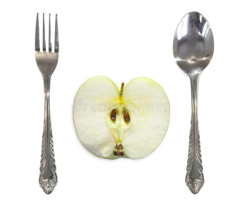 Download Apple Between Fork And Spoon Stock Photo - Image: 33689220