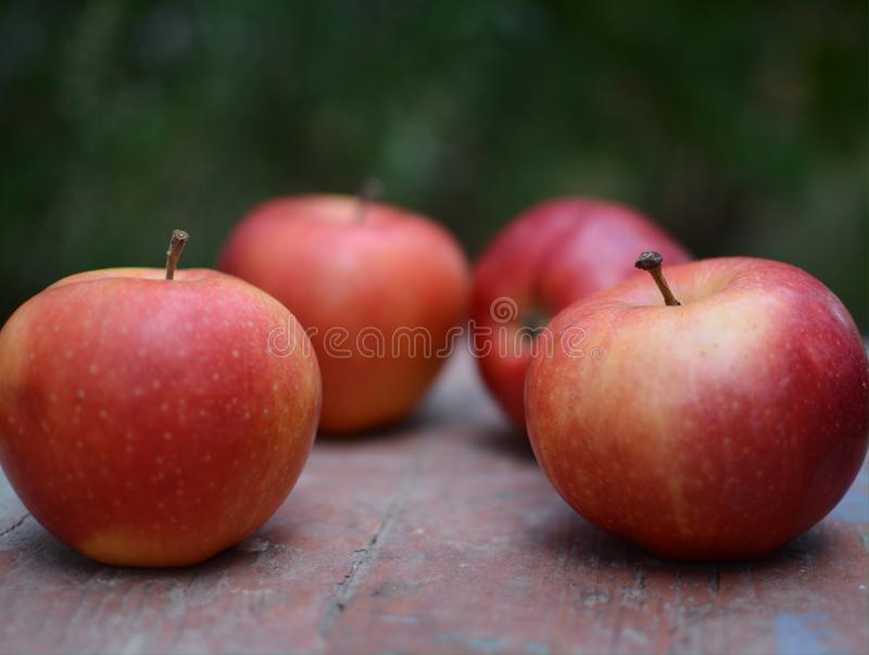 Red apples. On wood table royalty free stock images