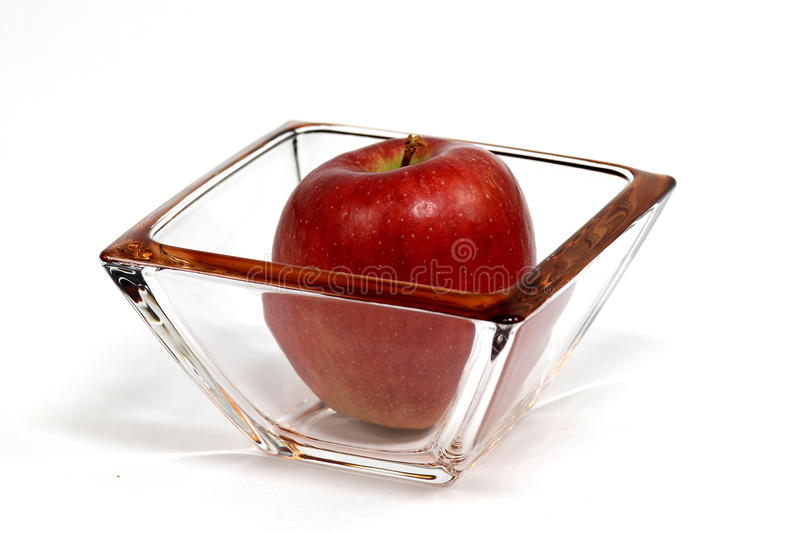 Apple and glass stock images