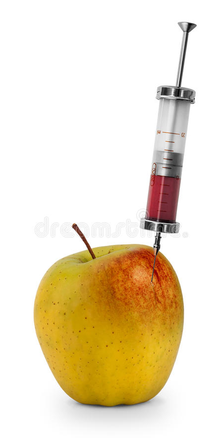 Apple GMO. Red liquid being injected into apple. Concept for genetically modified foods royalty free stock photography