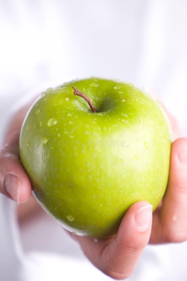 apple gospodarstwa zdjęcie royalty free