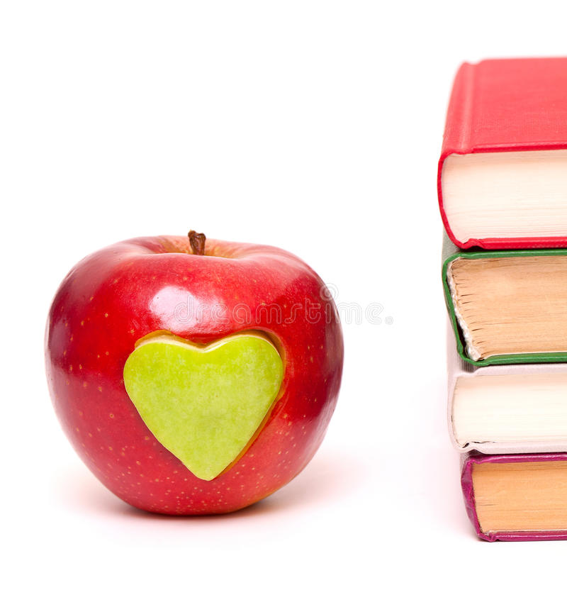 Download Apple With Green Heart And Books Stock Photo - Image of green, knowledge: 23744266