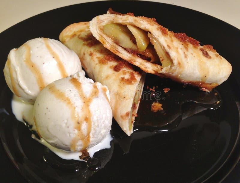 Apple handpajer med Vanilla Ice kräm royaltyfri bild