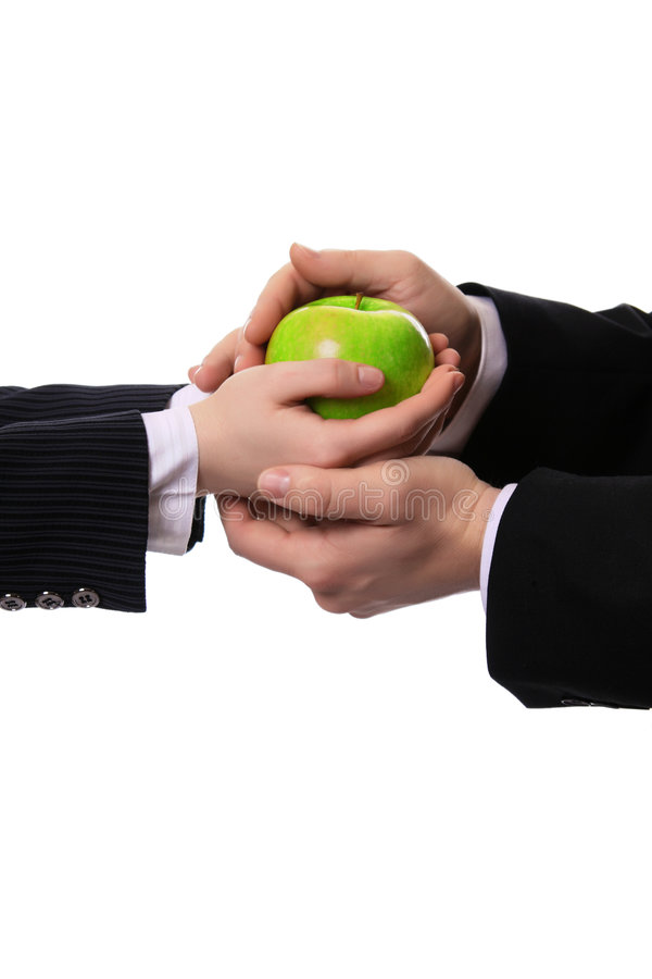 Apple in the hands of stock image