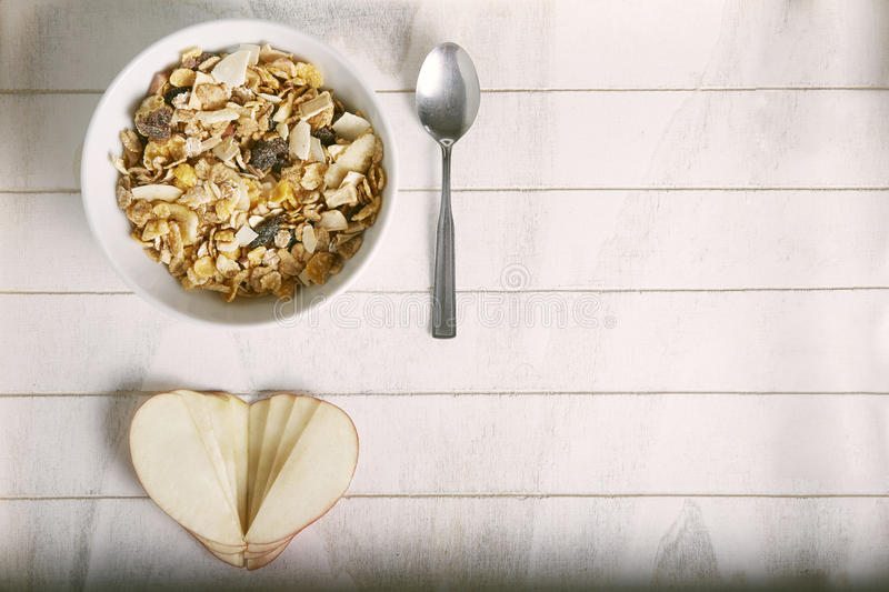 Apple heart with bowl of cereals stock images