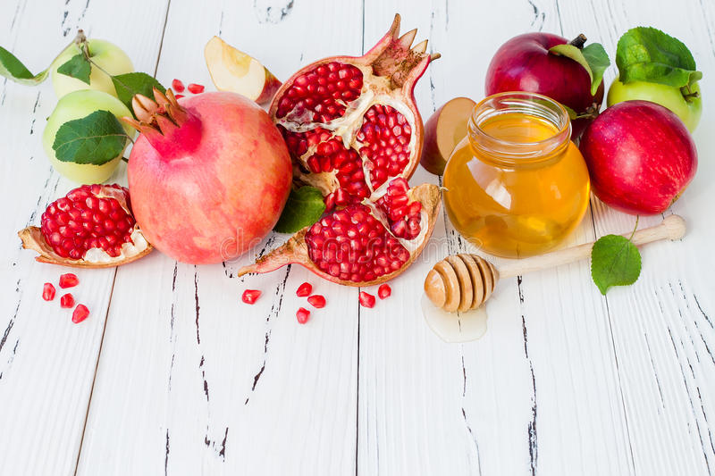 Apple and honey, traditional food of jewish New Year - Rosh Hashana. Copy space background. stock photos