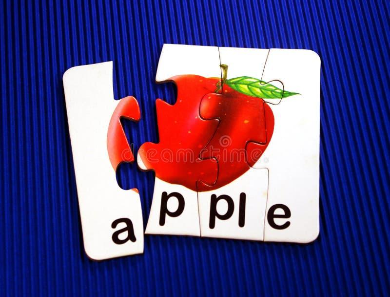 Apple i pussel royaltyfria foton