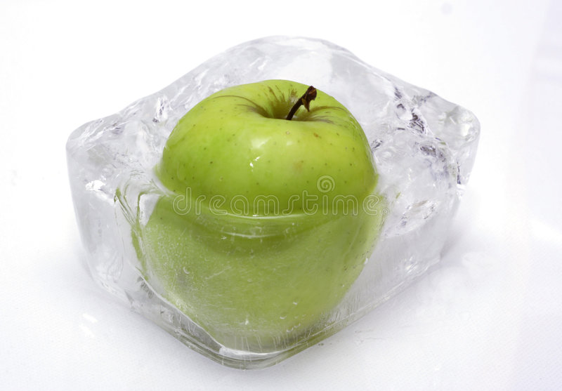 Apple in ice royalty free stock photography