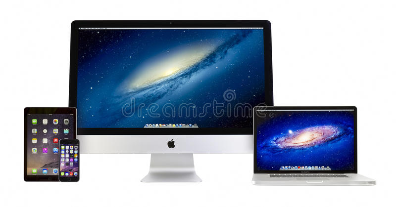 Apple iMac 27 duim, Macbook Pro, iPad lucht 2 en iPhone 6 stock fotografie