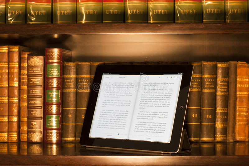 Apple ipad 2 in a library, warm colors royalty free stock photos
