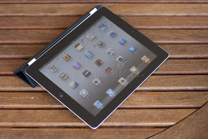 Apple Ipad 2 on a wooden table royalty free stock photos