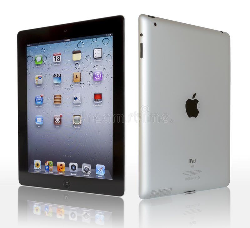 Apple iPad with clipping paths. Wi-Fi + 4G iPad 3 with iOS 5.1 by Apple Inc, the third generation iPad was released for sale by Apple Inc. The New iPad 3 boasts royalty free stock images
