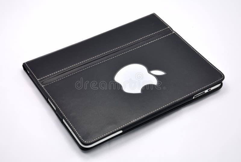 Apple Ipad con la cubierta de cuero imagen de archivo libre de regalías