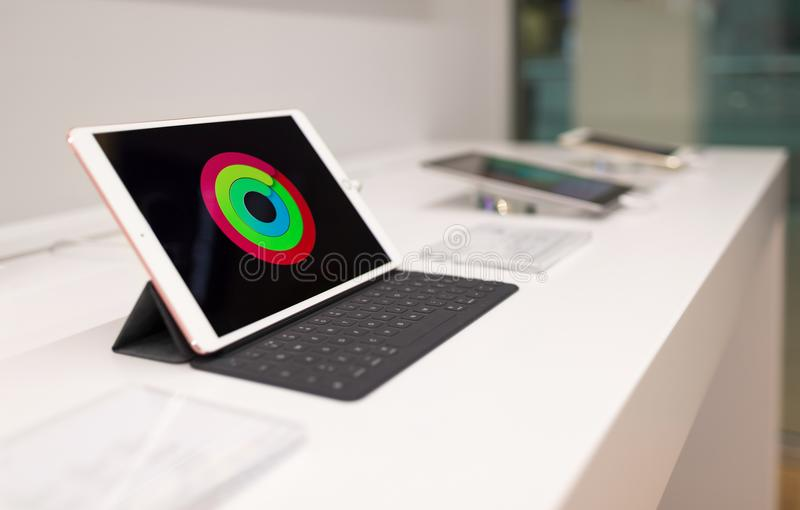 Apple iPad 10 Pro exposed with additional keyboard on white table, in electronic store royalty free stock image