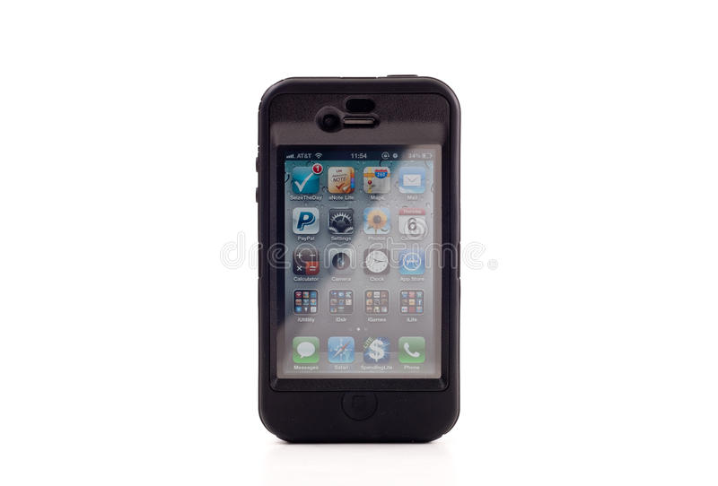 Apple iPhone 4 in Otterbox. Defender Series Protector Case royalty free stock photos