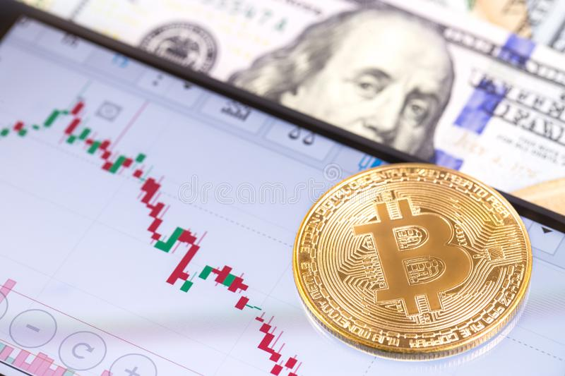 Apple iPhone 8+ and chart with bitcoin, dollars. Ekaterinburg, R royalty free stock photography