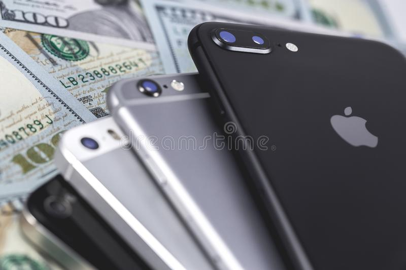 Apple iPhone devices and dollars. Ekaterinburg, Russia - September 12, 2018 stock photography