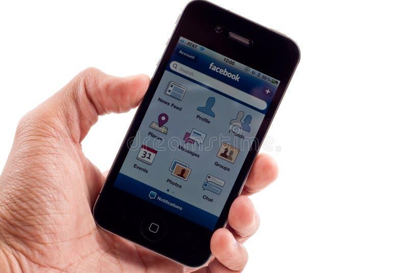 Apple iPhone Facebook Anwendung lizenzfreie stockfotografie