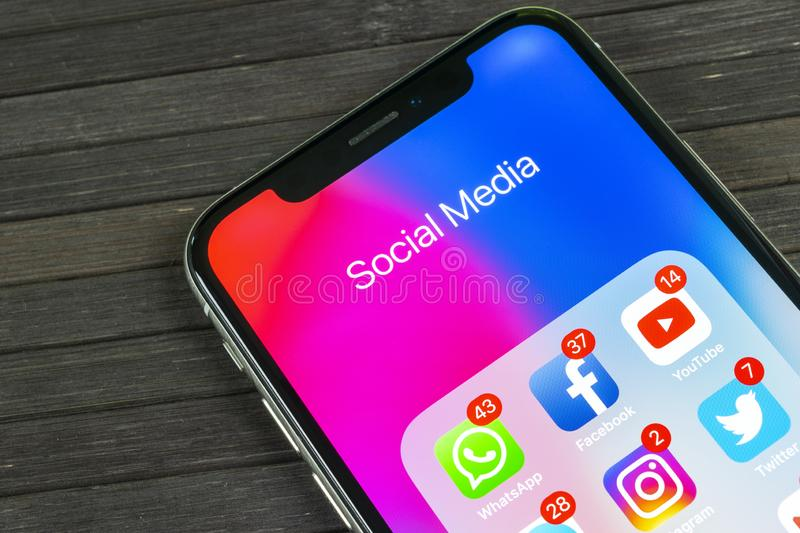 Apple iPhone X with icons of social media facebook, instagram, twitter, snapchat, google application on screen. Social media icons. Sankt-Petersburg, Russia stock photos