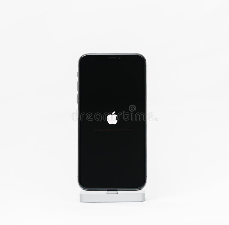 Apple iPhone X isolated white background apple logo stock photography