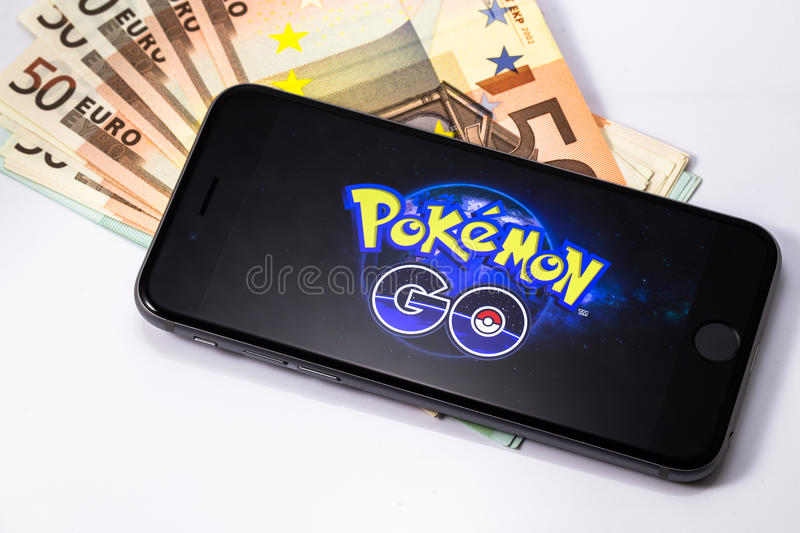 Apple iPhone 6s with Pokemon Go background on the screen. A free-to-play augmented reality mobile game developed by Niantic for iOS and Android devices royalty free stock photos