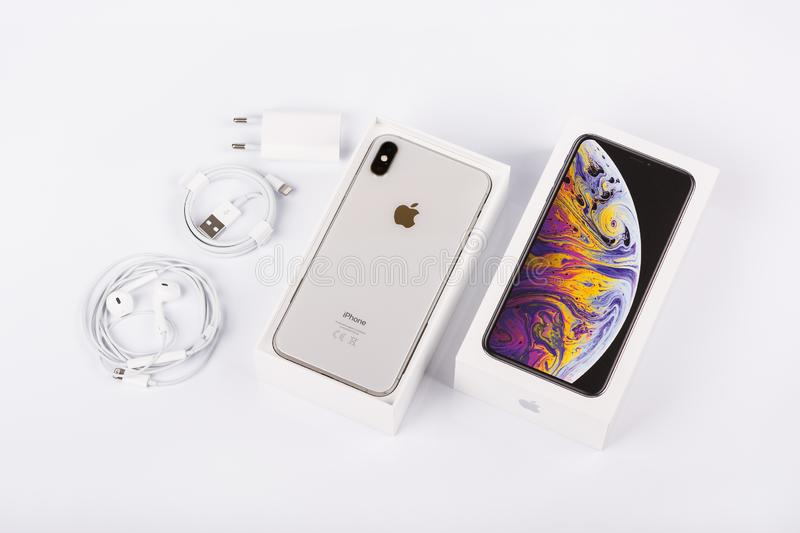 Apple iPhone Xs Max Silver on white background, back view. Charger, earpods and adapter. royalty free stock image