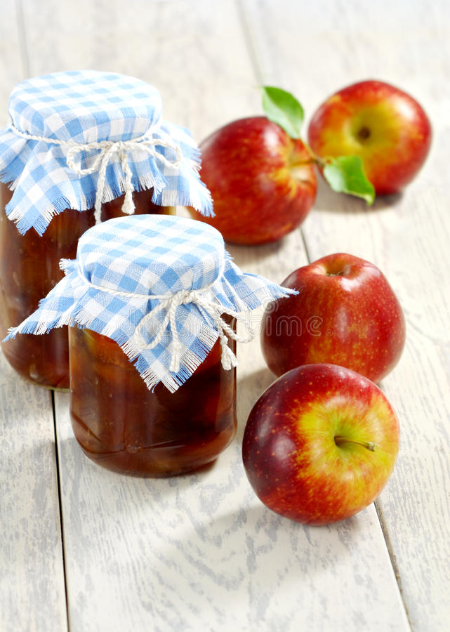 Apple jam and red apples royalty free stock images