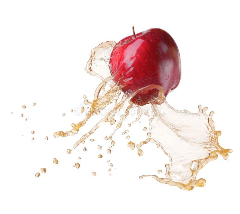 Apple in juice stock photos