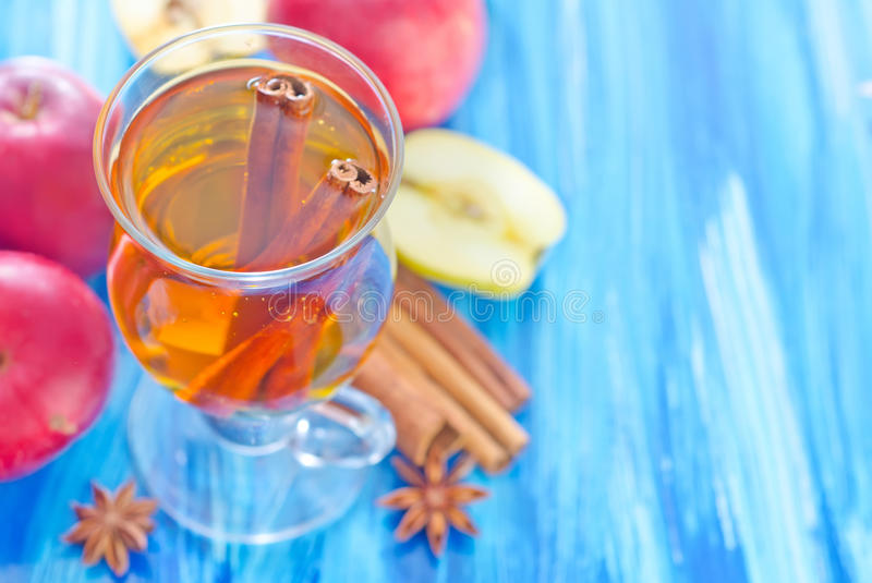Apple juice. With cinnamon on a table stock images