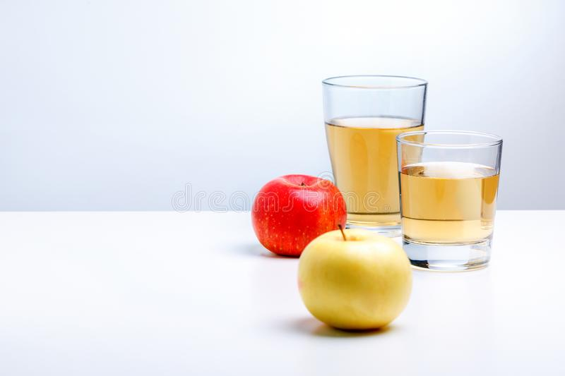 Apple juice in glass and apples. copy space stock images