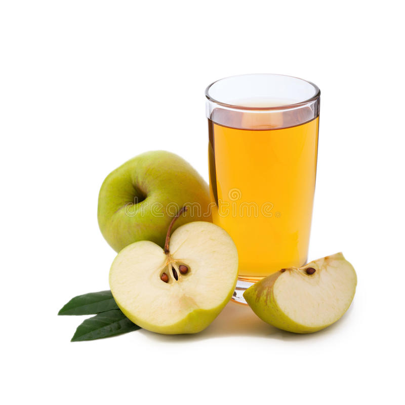 Apple juice in glass isolated. Apple juice in glass and apples with green leaves isolated on white background stock images
