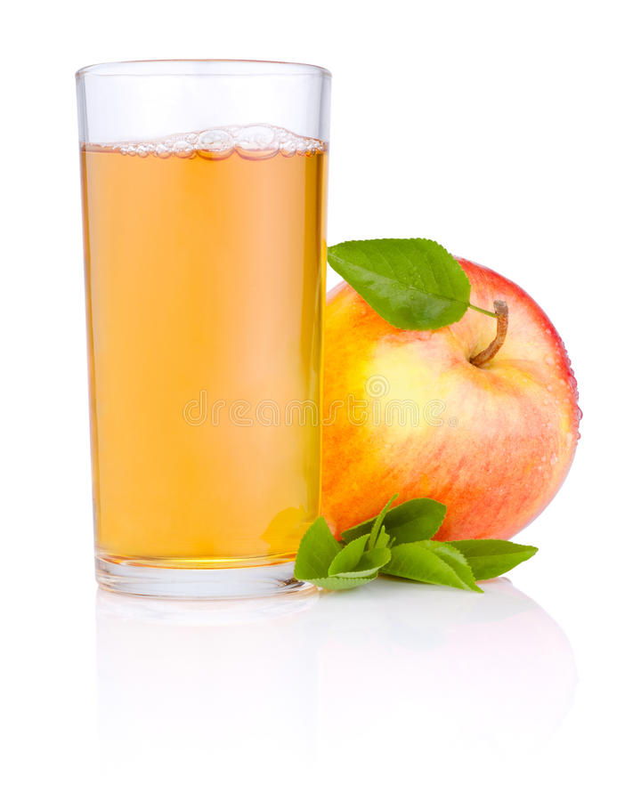 Apple juice in glass and Red apple with green leaf royalty free stock photos