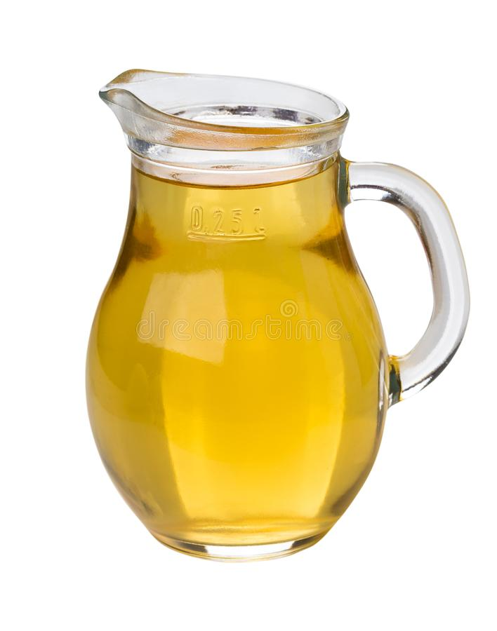 Apple juice in glass transparent jug isolated on white stock images