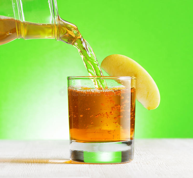 Free Apple Juice Pouring From Jug Into A Glass Royalty Free Stock Images - 40898519