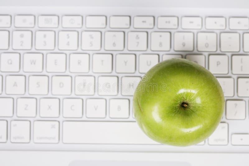 Apple on keyboard stock photography