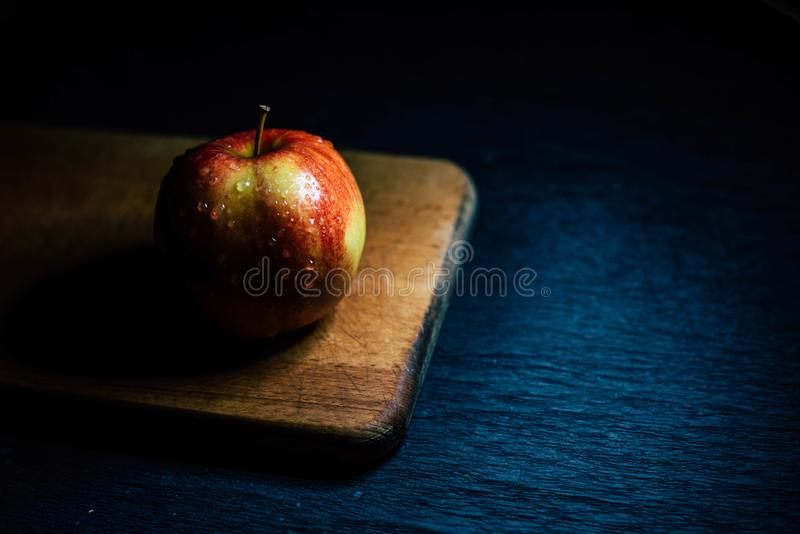 Apple on the kitchen board stock photo