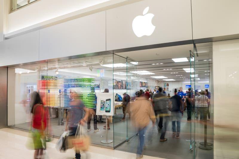 Apple lager i galleria av Amerika royaltyfria bilder