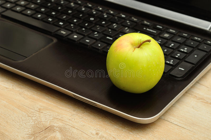 Apple and laptop stock photo